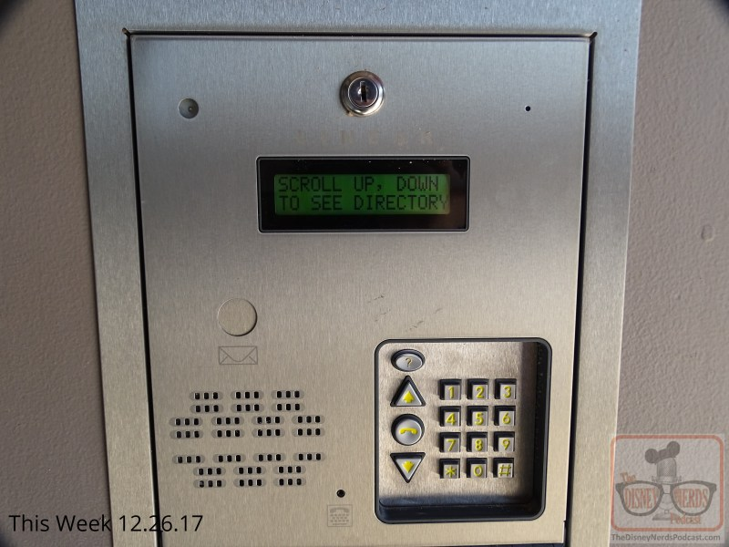 """Be sure to look for this hidden gem at the """"grand lofts apartments """"on Grand Avenue during your next visit . Step right up to the door and discover on the right a buzzer panel enabling you to actually call apartment residents. The directory is filled with various names of upper management at the Studios. Don't be shy to click on the help button to activate a voice directing you to make your name selection. Complete your call and then watch for a text to appear on the screen. Sorry, you will learn that the line is unfortunately busy. By the way, you will also notice a new touch with an ice cream cart for treats and potted flowers along the avenue."""