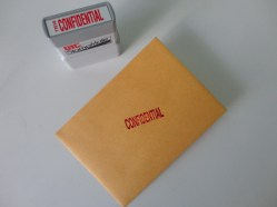 Stamp the front! Cut some white paper to size and write a confidential, super top secret message for your significant other!