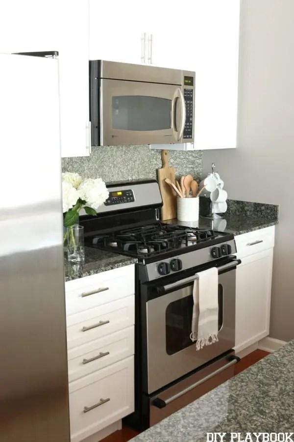 white kitchen with bar pulls