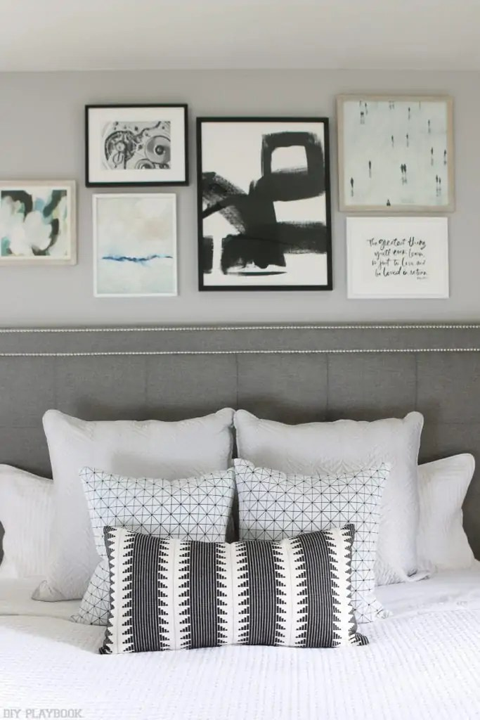 how to hang a gallery wall over the bed
