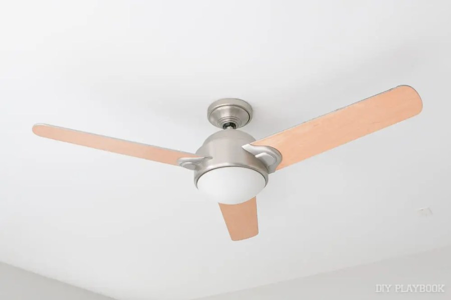 10 Tips To Install A Ceiling Fan By Yourself   DIY Playbook Here s a close up of our old ceiling fan with the light woden blades  Can