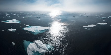 A photograph depicting several glaciers off the coast of Greenland.