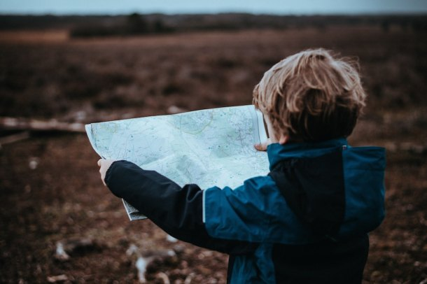 boy looking at map as a guide