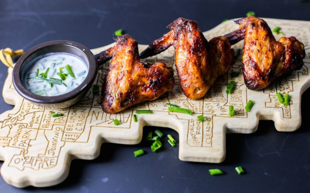Chicken wings on a cutting board