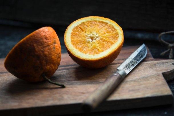 oranges on a cutting board