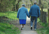 Oldsters holding hands and walking