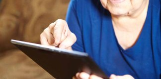 Elderly woman using tablet (Photo credit: Dreamstime)