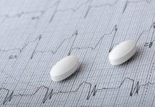 Value-based insurance design: pills on an EKG recording 2048 x 1367
