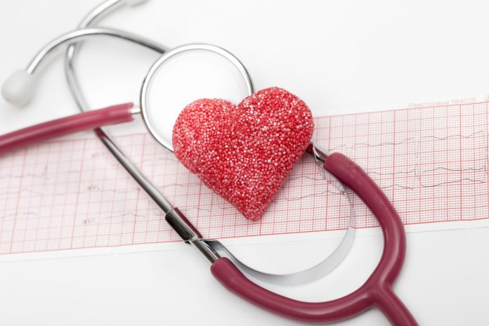 Sugary heart on stethoscope and EKG 2048 x 1365