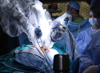 Robotic Surgery. Medical robot. Medical operation involving robo 1000 x 563
