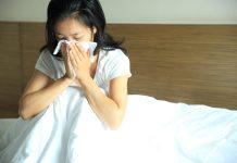 sneezing asian girl allergies