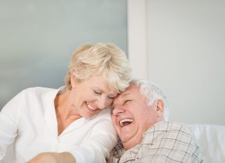 Happy senior couple laughing 2048 x 1365