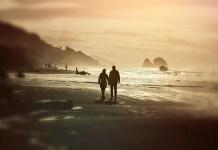 Couple on beach at dusk 1280 x 853