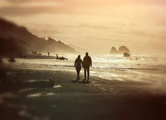 Couple on beach at dusk 1280 x 853