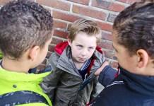 Two boys bullying a third at school 1500 x 994