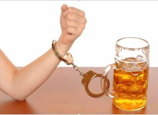 Woman's wrist handcuffed to beer mug 1000 x 688