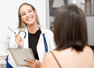 YOung female doctor interviewing female patient 1500 x 1001