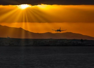 airplane landing at sunset 1500 x 843