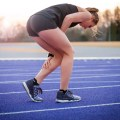Young woman runner with injury to calf 1500 x 1000