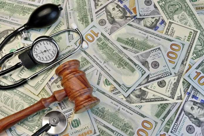 Judges Gavel And Medical Tools On Dollar Cash Background