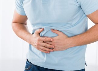 Man holding his stomach in pain 1024 x 683