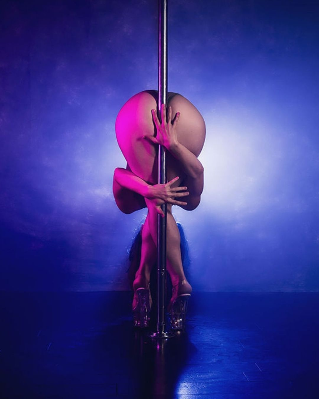 Pole dance fitness students at the Dollhouse Fitness