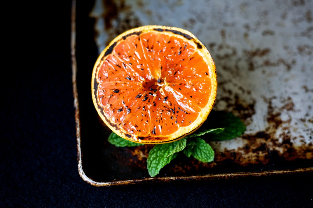 broiled grapefruit on a sheet pan with mint