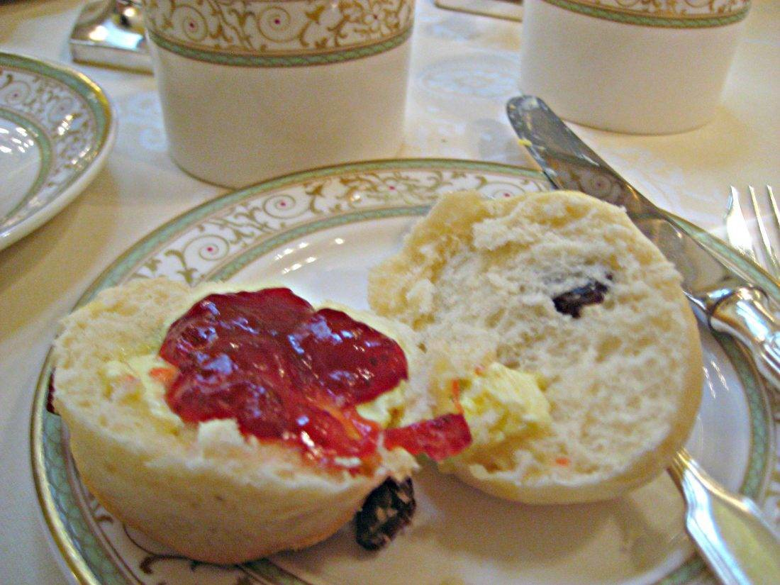 Scone with butter and strawberry jam