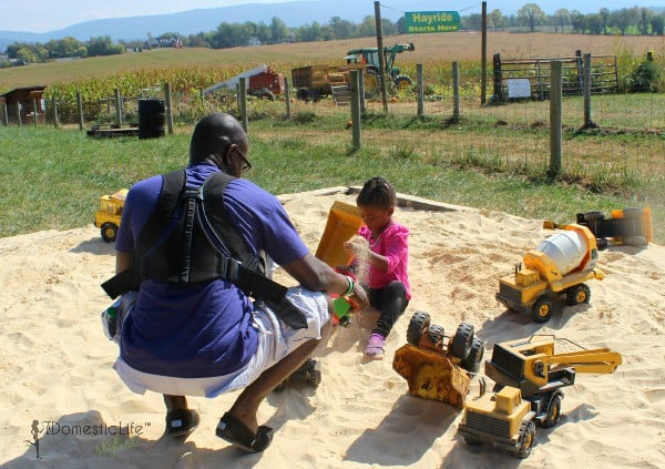 playing in sandbox, father daughter activities