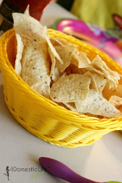 tortilla chips in yellow baskets