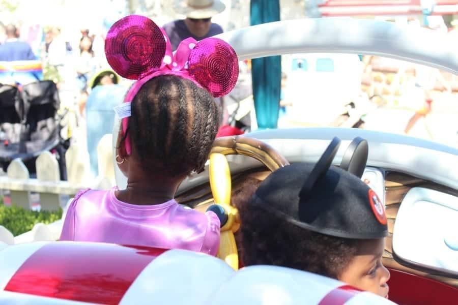 kids in disney car at Disneyland