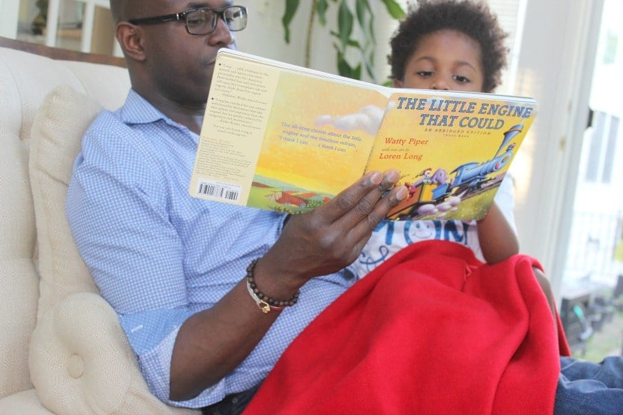 father reading son a story