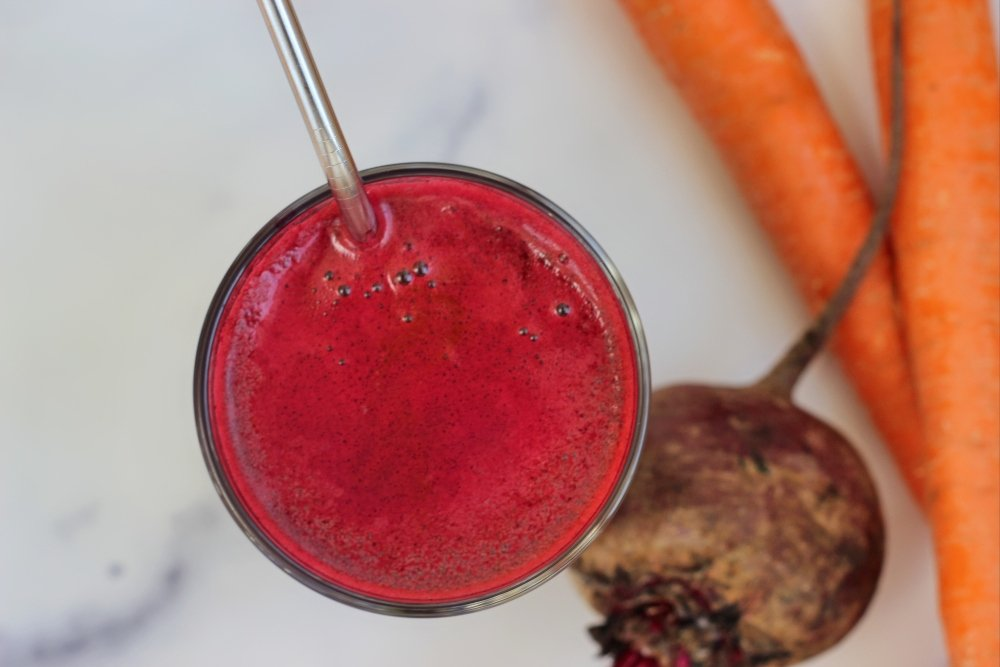 Tall glass of beetroot and carrot juice
