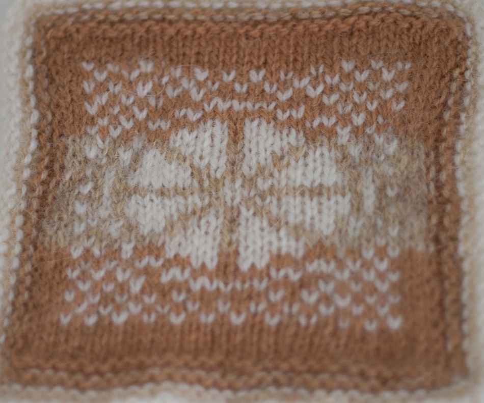 The sliced cake motif from the Fruitcake swatch in the KNITSONIK Stranded Colourwork Sourcebook worked in just three foamy latte shades of Jamieson & Smith yarn