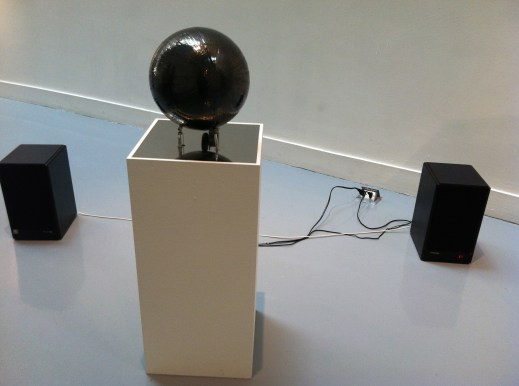 This bizarre contraption is a sphere of layered cassette tape which it plays.
