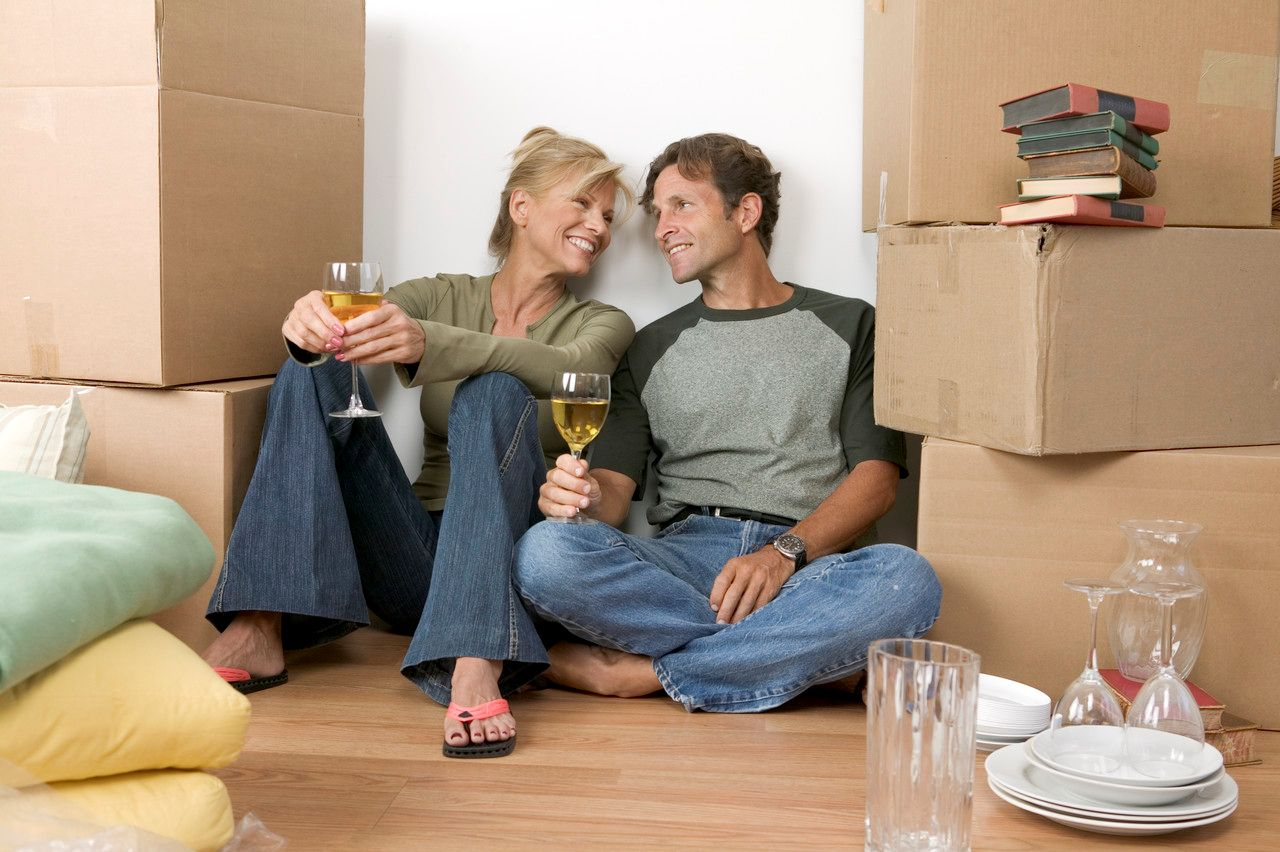 Photo: Smiling couple on moving day
