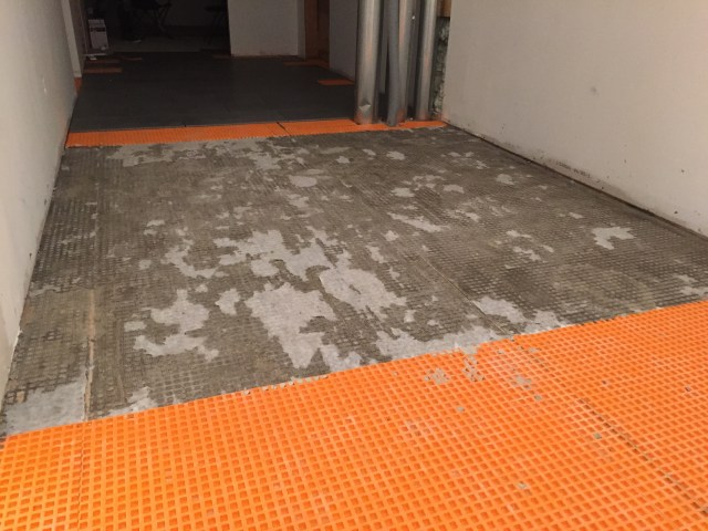 The aftermath of tearing up our tiles & removing the Ditra underneath