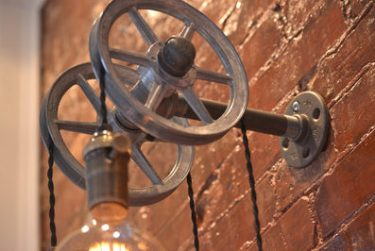 Rustic pulley wall light
