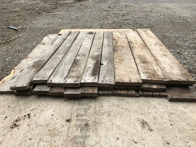 Reclaimed pallet wood for the feature wall of our master bedroom makeover.
