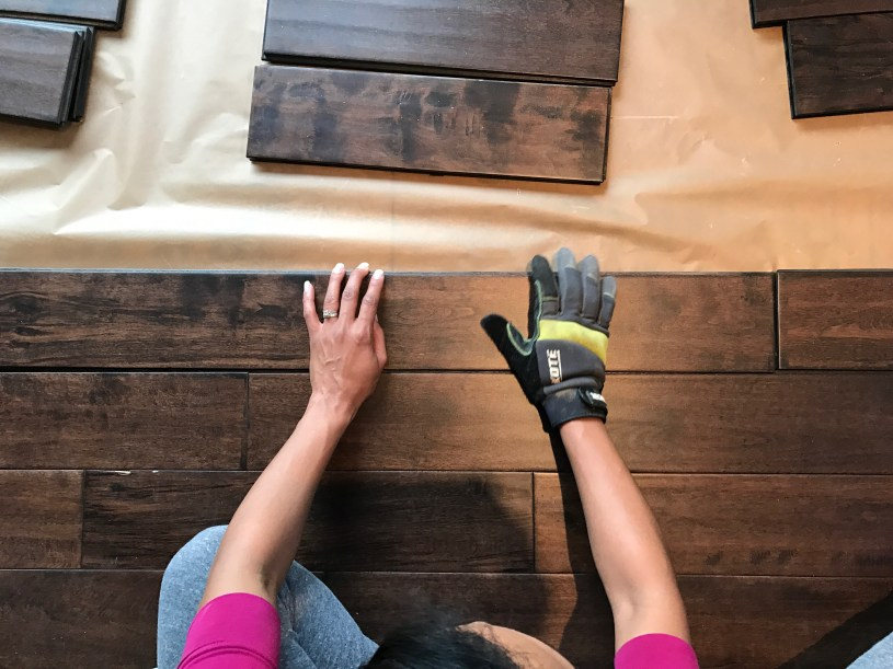 """Our beautiful 5"""" handscraped maple hardwood being installed"""