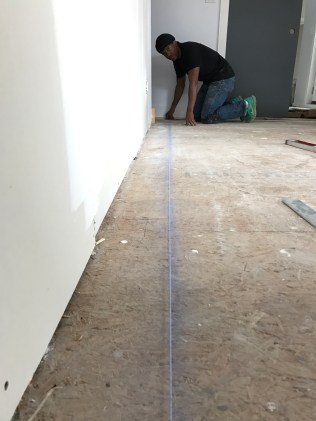 Installing hardwood - always start with a chalk line