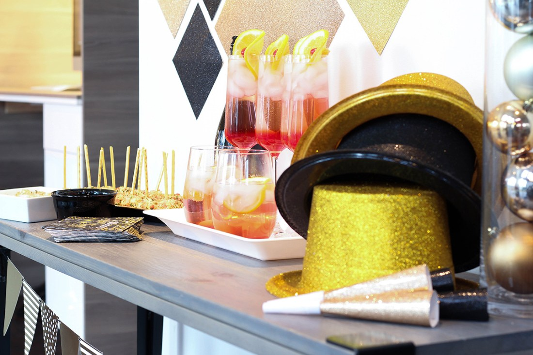NYE black and gold decor with party favours