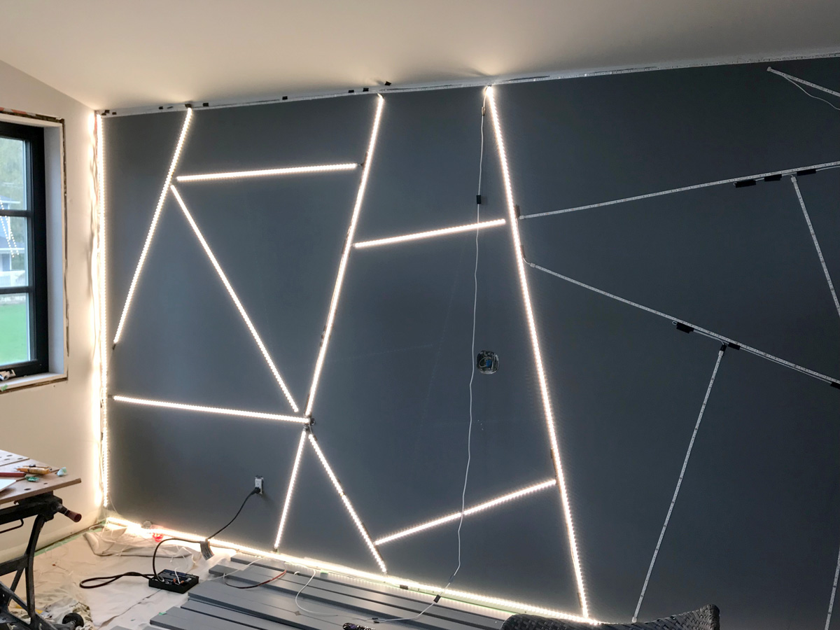Geometric feature wall wired with LED tape lights & half lit