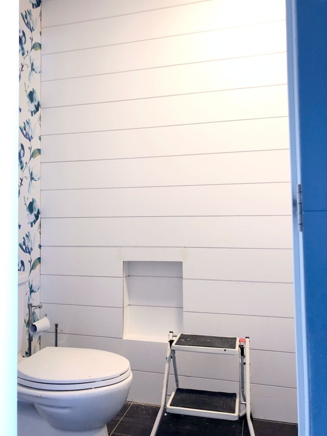 Modern shiplap installed horizontally with a niche inset into the wall
