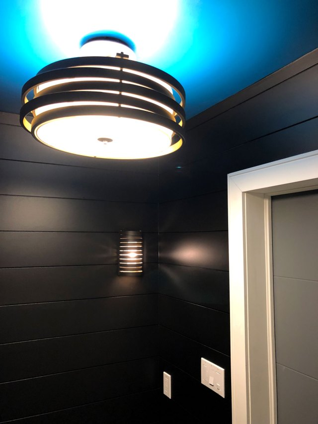 Everything is now so sleek and striking. The dark walls are bold & the sleek ambient lighting gives the powder room a rich and moody feel.