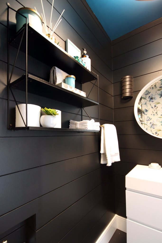 The black on black shelf from JYSK display various decor accents