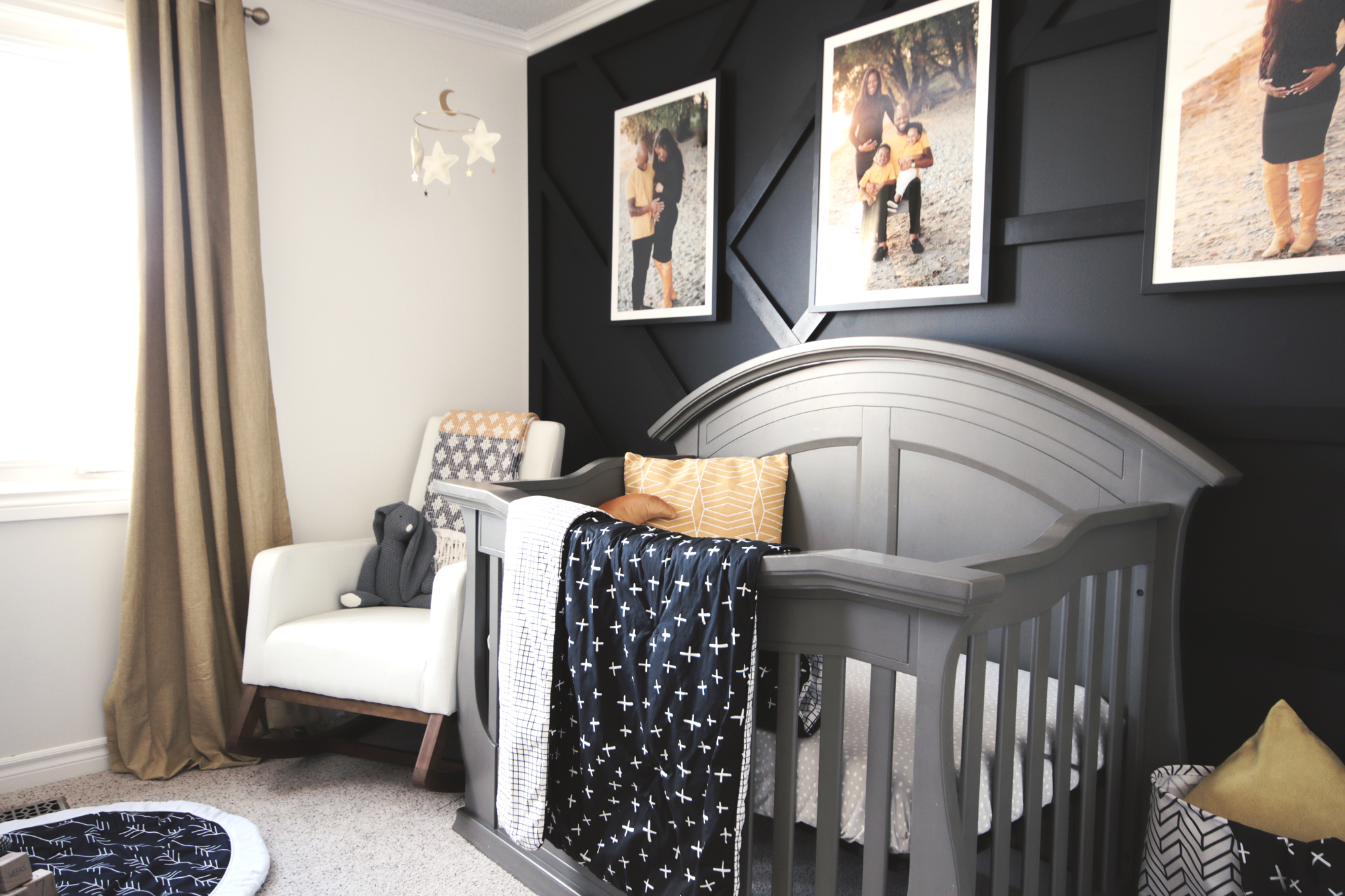 Geometric accents in the crib bedding play off the geometric feature wall