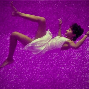 Falling woman on purple background for the meaning of falling in a dream