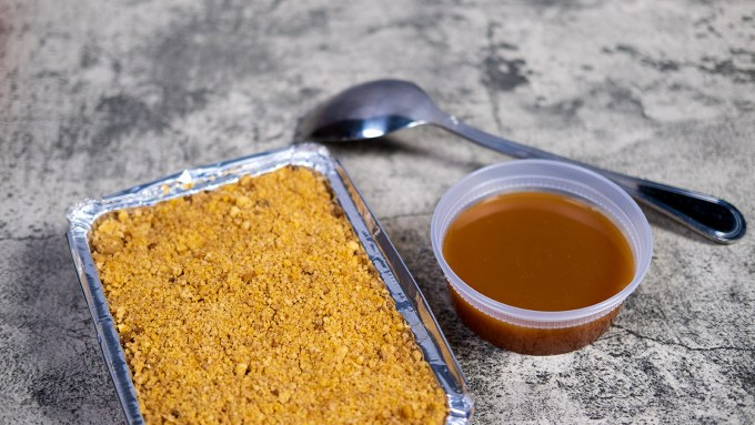 Easter Brunch Apple Cobbler served with a Caramel Sauce and pictured with a serving spoon.