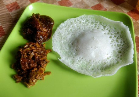 Pandhi curry, pandhi with bamboo, and rice appam at Coorg Cuisine